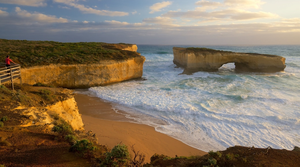 Southwest Victoria featuring waves and a sandy beach