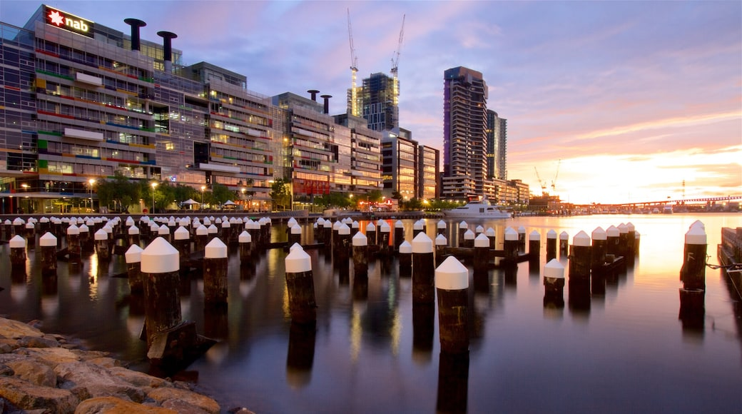 Victoria featuring a bay or harbour, a sunset and a city