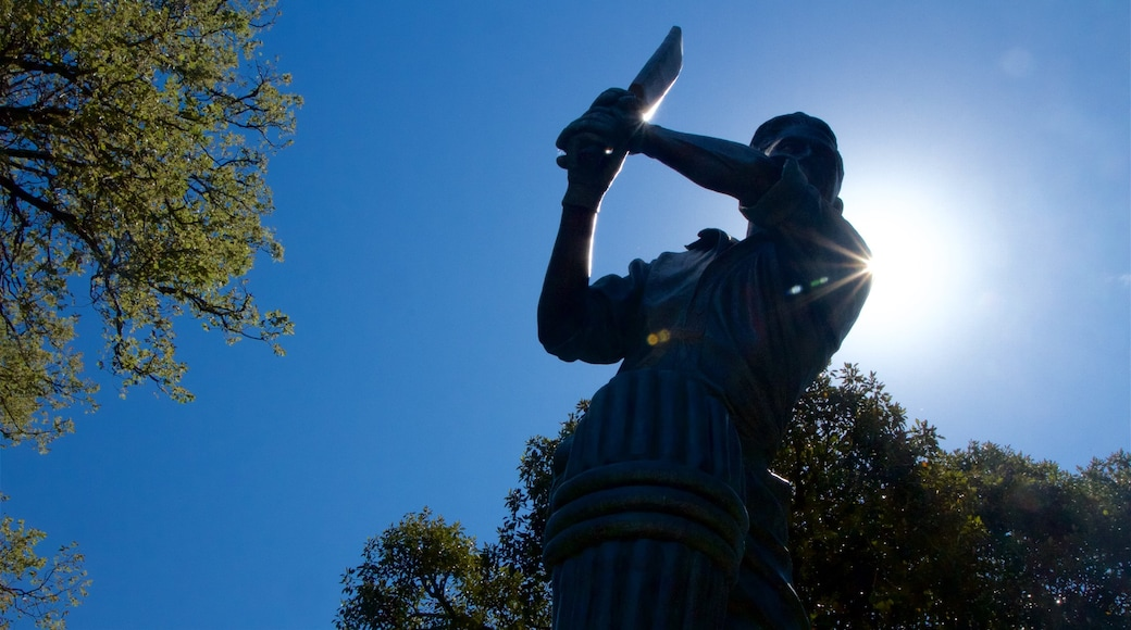 Melbourne Cricket Ground featuring a statue or sculpture