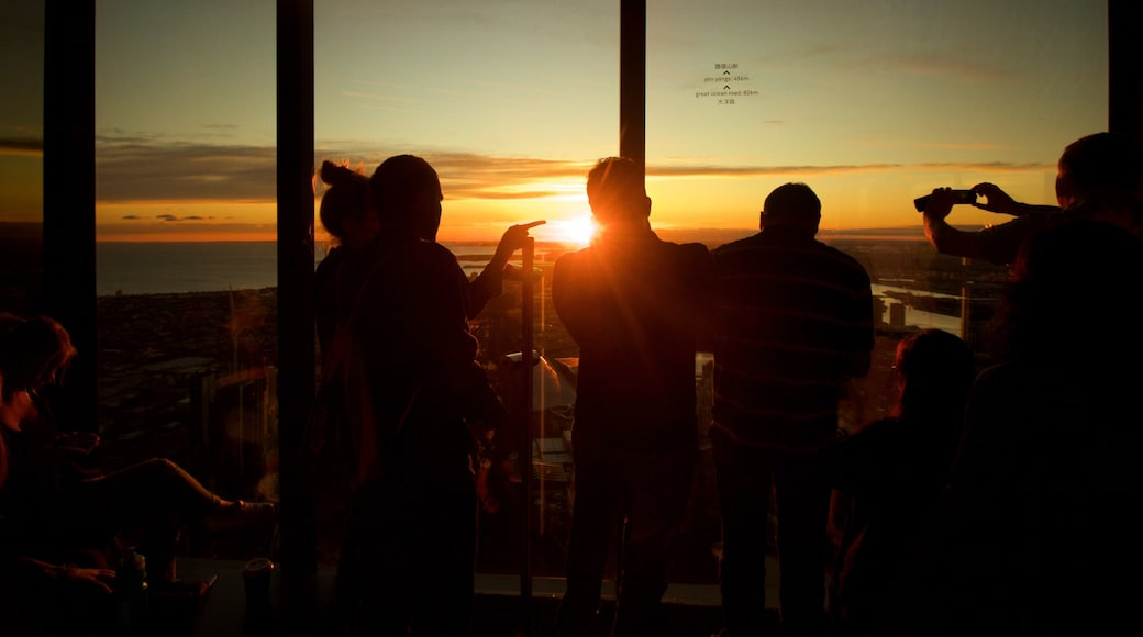 Eureka Tower which includes views and a sunset as well as a small group of people