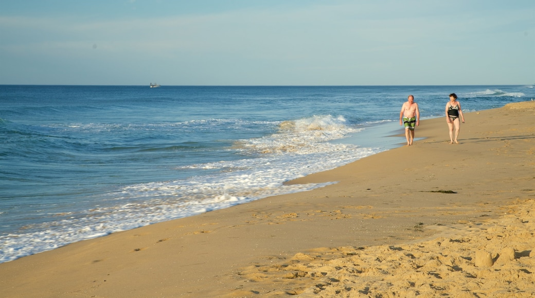 Gippsland featuring a bay or harbor and a sandy beach as well as a couple