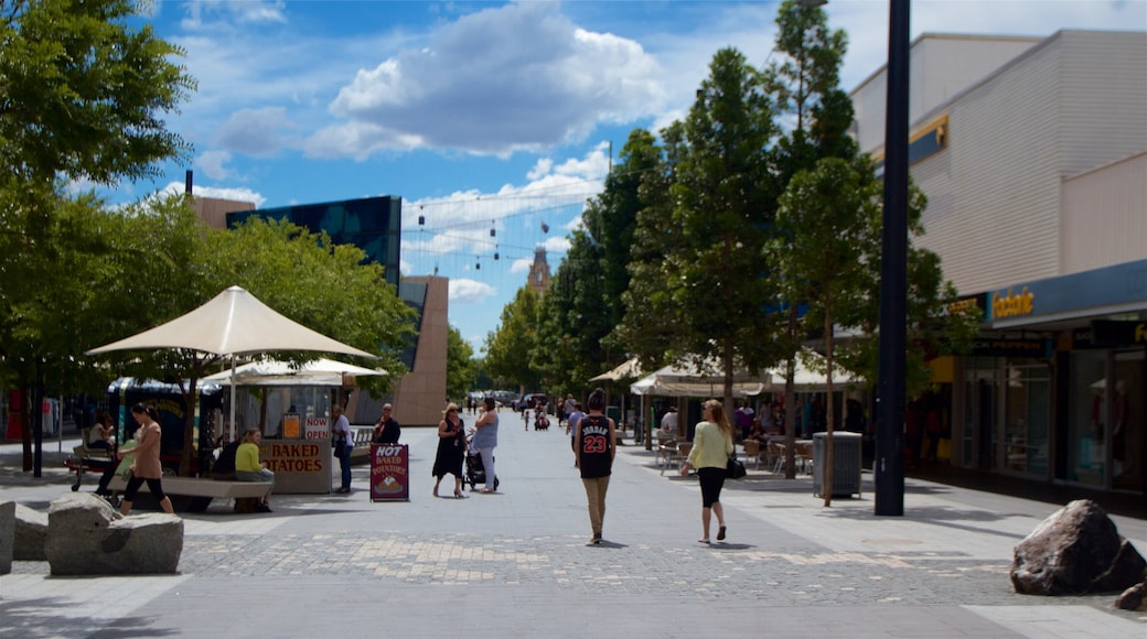 Bendigo featuring a square or plaza as well as a small group of people
