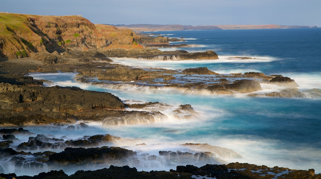 Phillip Island featuring a bay or harbour, rugged coastline and surf