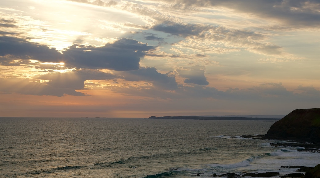 Phillip Island featuring a sunset, a bay or harbour and rugged coastline