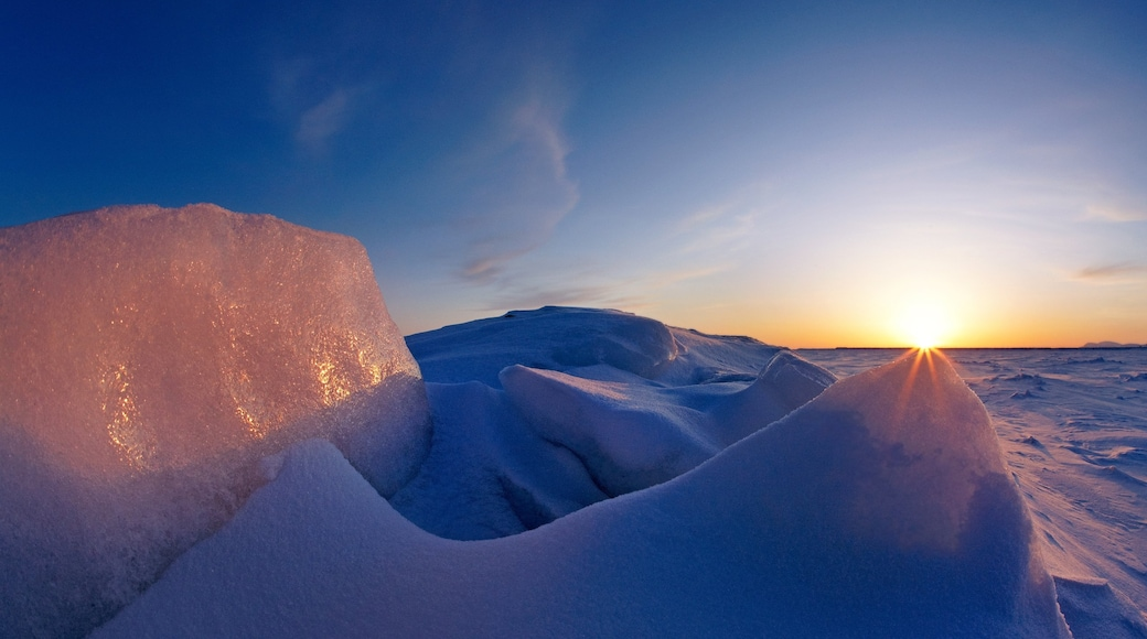 Nome featuring a sunset and snow