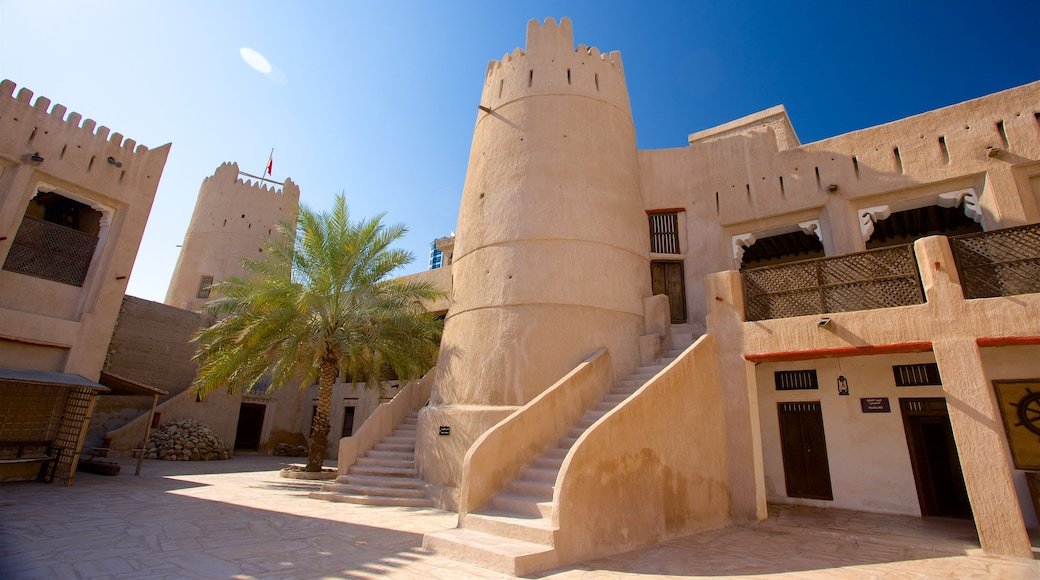 Ajman which includes heritage architecture and desert views