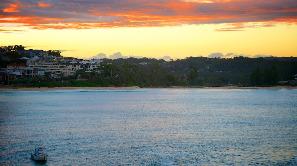Terrigal which includes a sunset, a bay or harbour and a coastal town