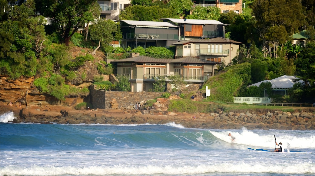Avoca Beach which includes waves, a coastal town and a bay or harbour