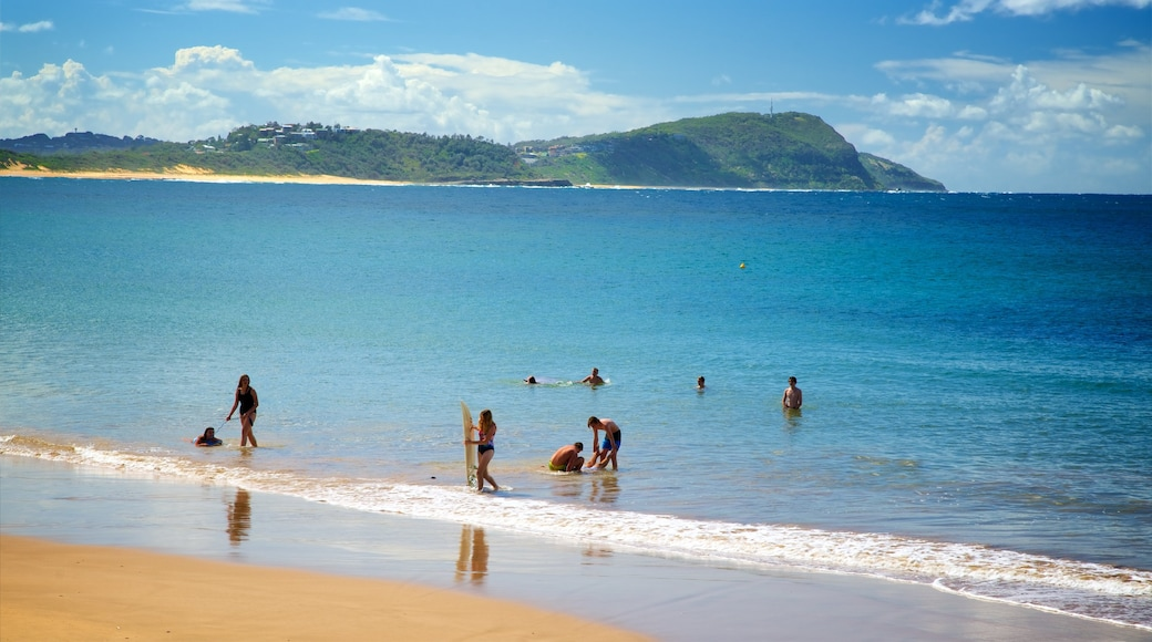 Terrigal showing a bay or harbor and a sandy beach as well as a small group of people