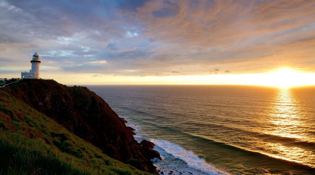 Cape Byron Lighthouse which includes a sunset and rocky coastline