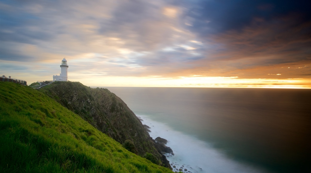 Cape Byron Lighthouse featuring a lighthouse and a sunset