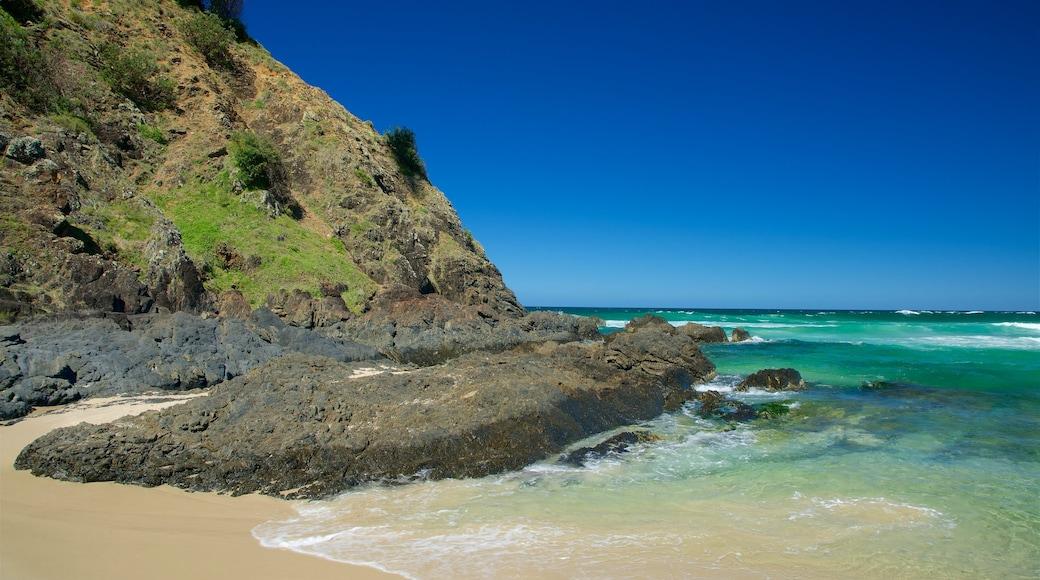 Tallow Beach showing a beach and rugged coastline