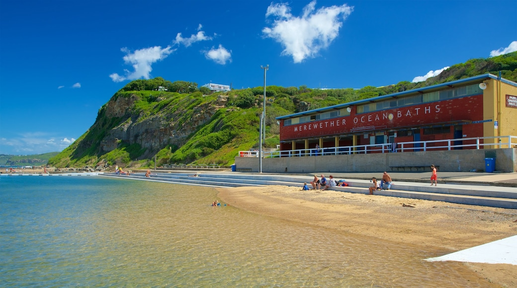 Newcastle which includes a pool and general coastal views as well as a small group of people