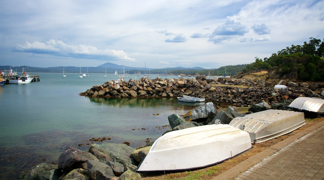 Eden featuring a bay or harbour and rocky coastline