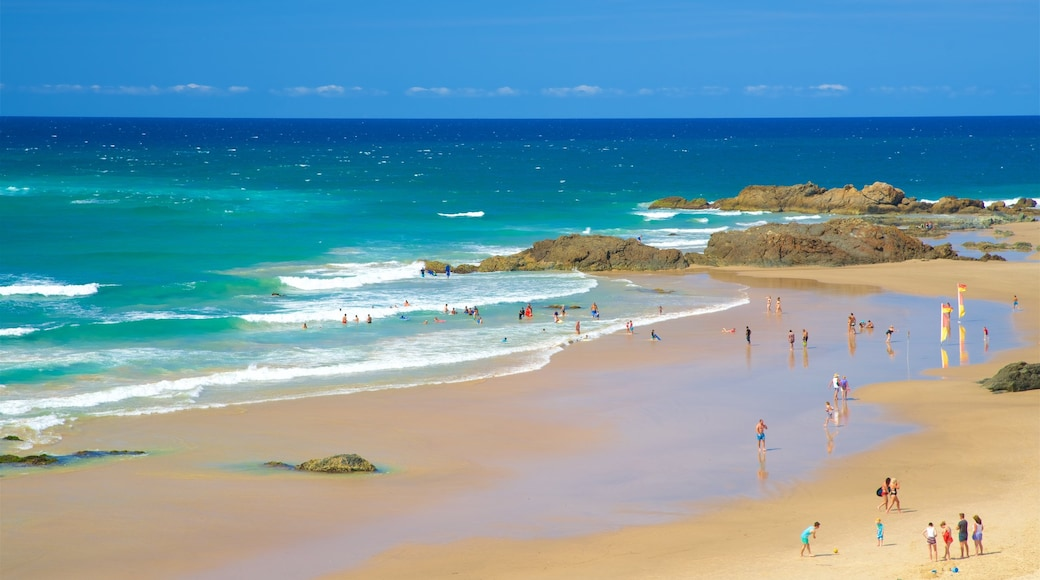 Port Macquarie showing a beach, rocky coastline and swimming