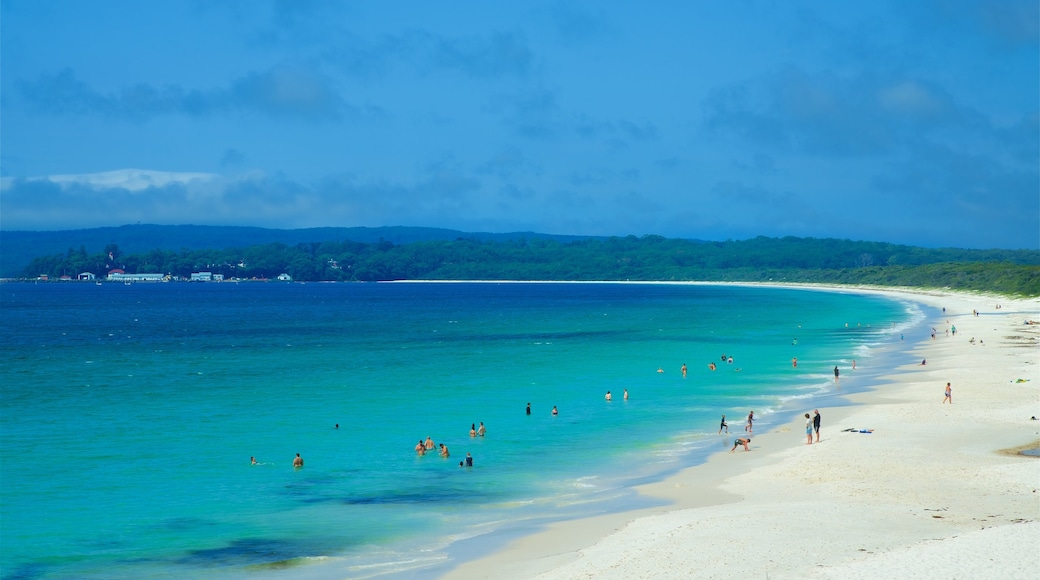 Huskisson featuring a sandy beach and general coastal views as well as a large group of people