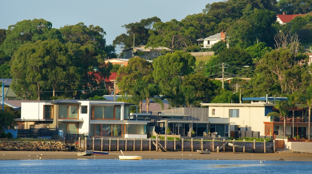 Merimbula which includes a house and a beach