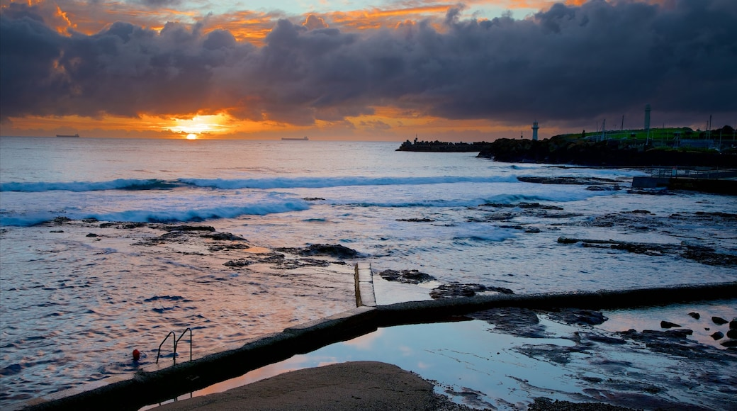 Wollongong North Beach featuring a sandy beach, general coastal views and a sunset