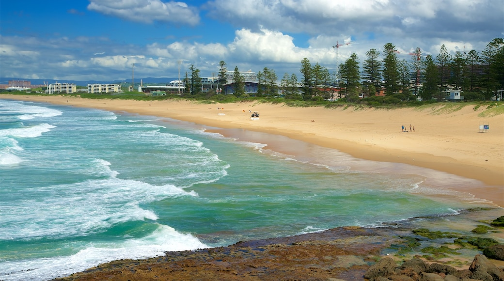Wollongong South Beach featuring rocky coastline and a beach