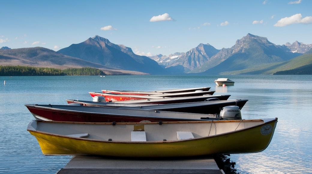 Bigfork showing a lake or waterhole, mountains and kayaking or canoeing