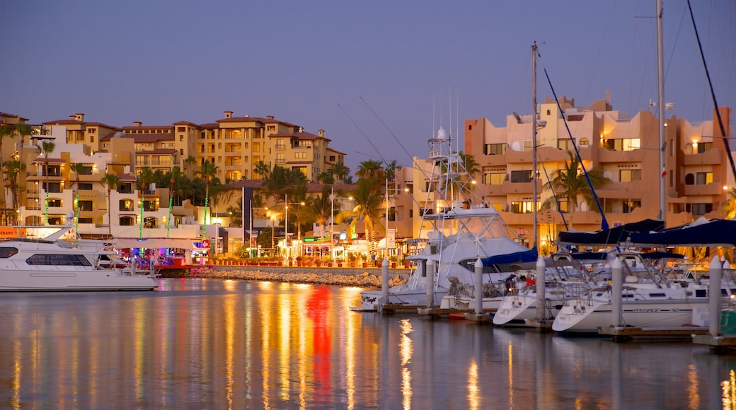Mexico which includes a coastal town, a bay or harbour and night scenes