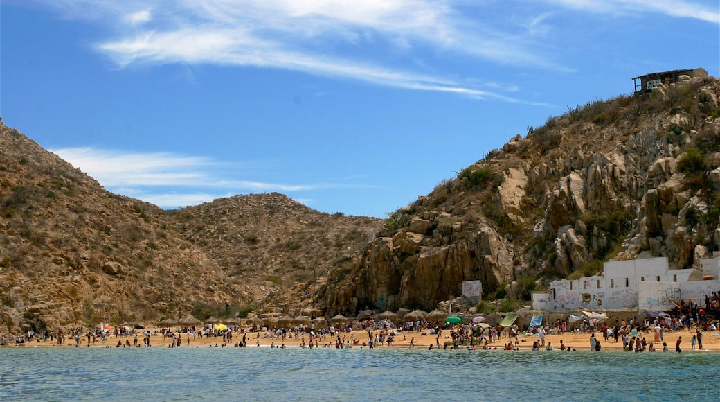 Mexico showing rocky coastline, a bay or harbour and a coastal town
