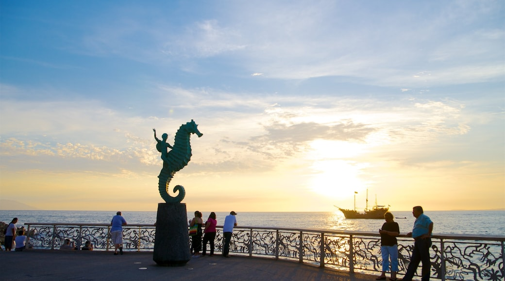Mexico showing outdoor art, a bay or harbour and a sunset