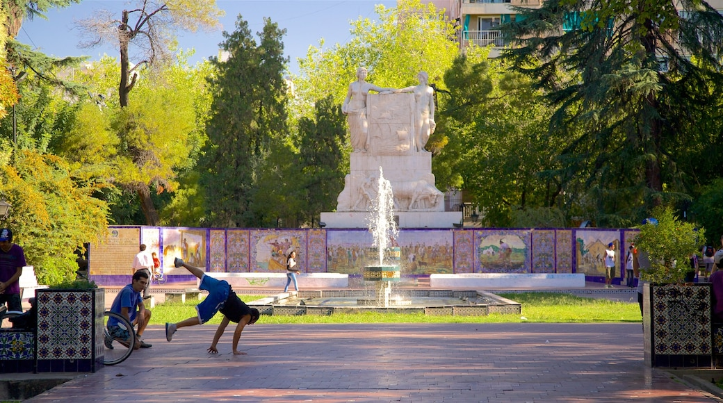Mendoza which includes a park and a fountain as well as a small group of people