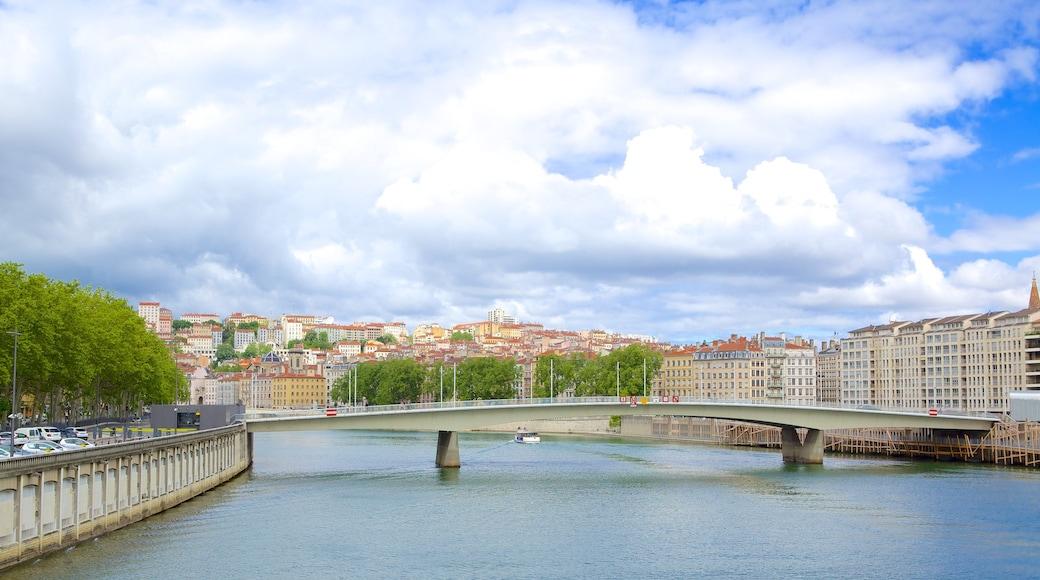 Lyon showing a city, a bridge and a river or creek