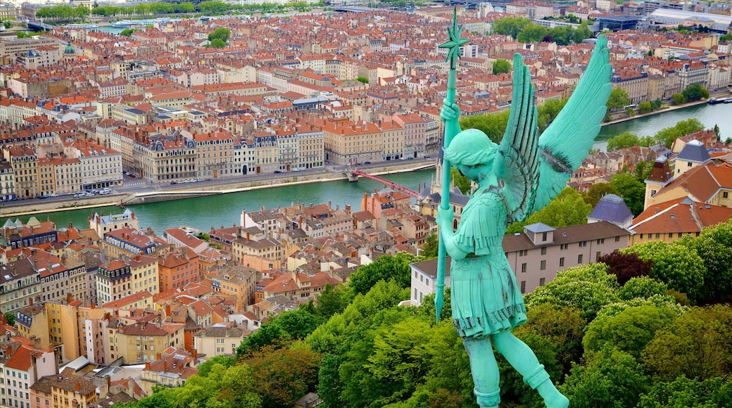 Lyon featuring a city, a river or creek and a statue or sculpture