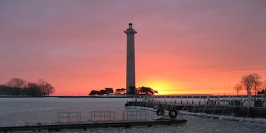 Perry\'s Victory and International Peace Memorial which includes a sunset and a river or creek