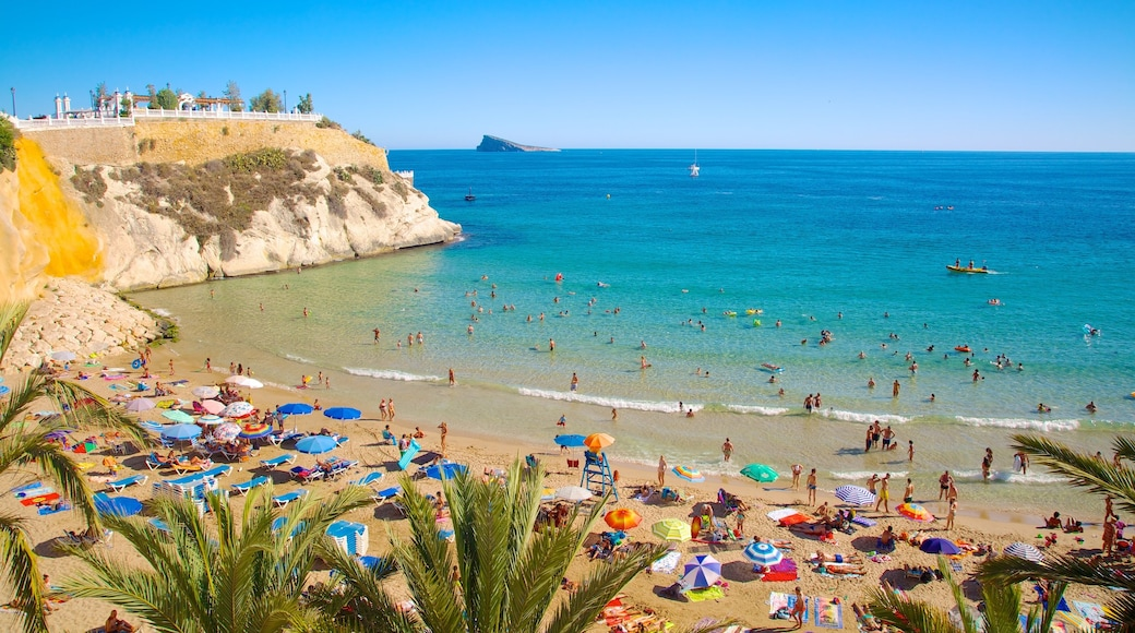 Benidorm which includes a sandy beach as well as a large group of people