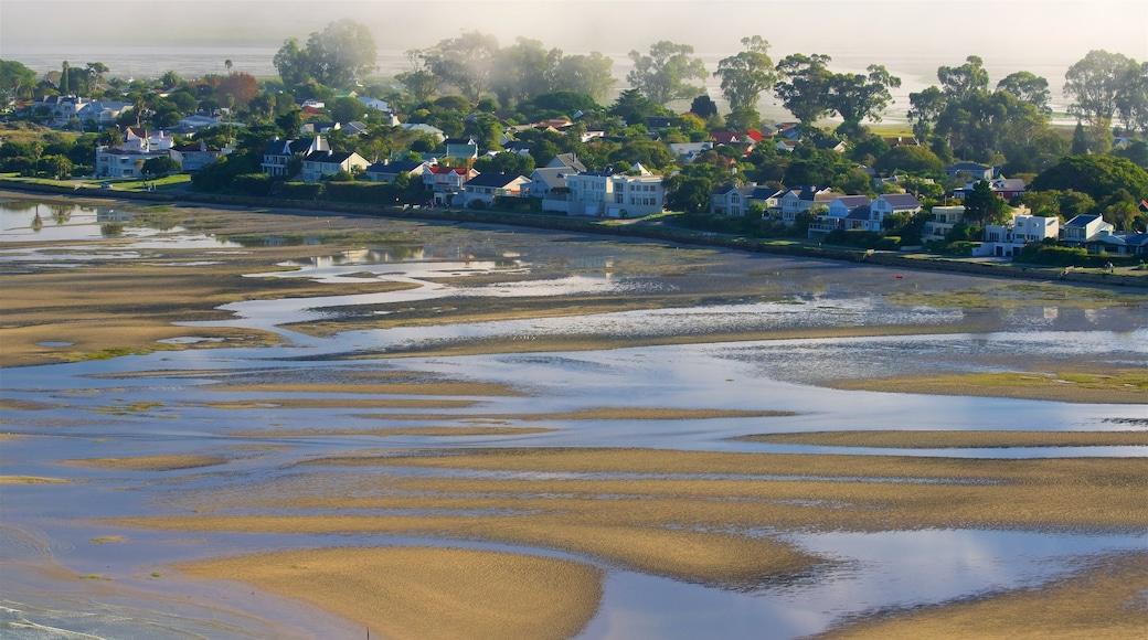 Knysna som visar en strand, en solnedgång och kustutsikter