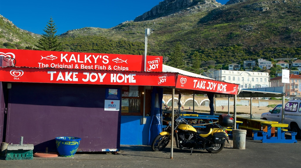 Kalk Bay which includes outdoor eating, a beach bar and signage