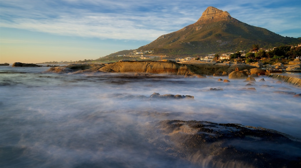 Camps Bay Beach featuring rugged coastline and waves