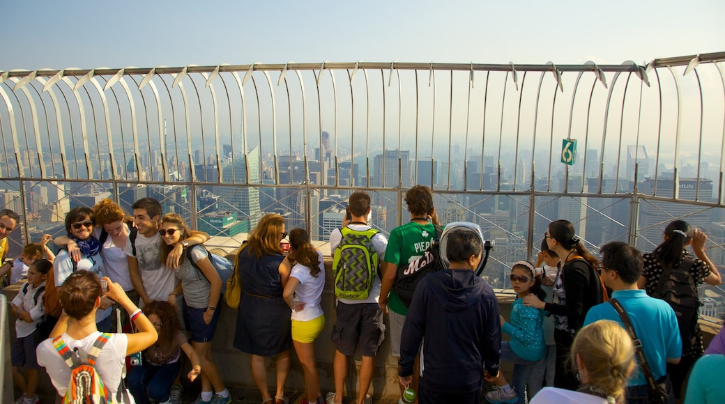 Empire State Building which includes a high-rise building, a city and views