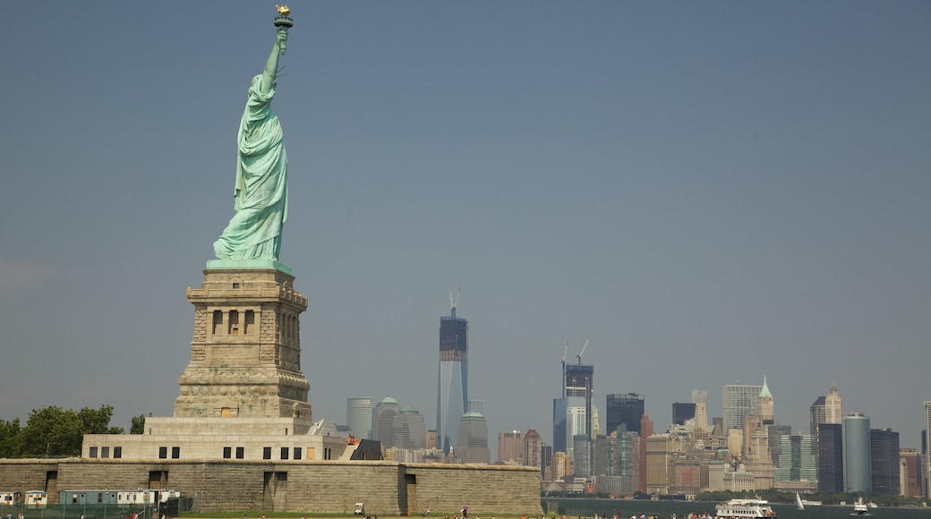 Statue of Liberty which includes a statue or sculpture, a city and a monument