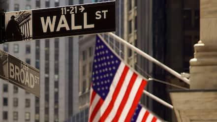 Wall Street - Financial District showing a city and signage