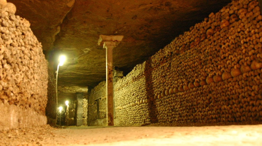 Paris Catacombs which includes heritage architecture, a cemetery and interior views