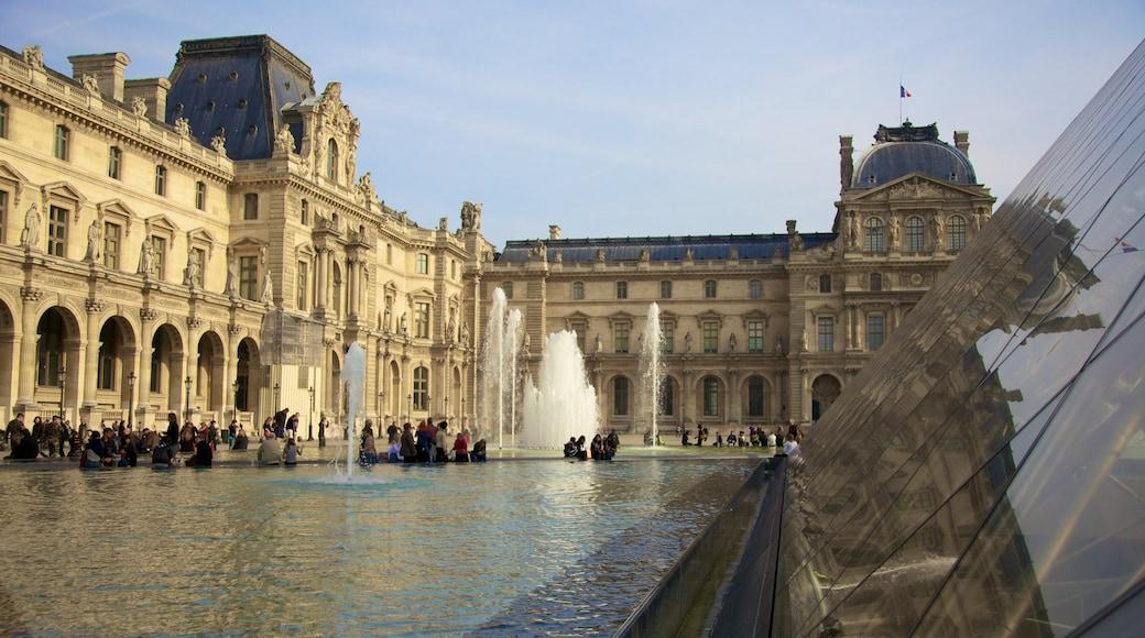 Ile-de-France som visar en fontän, chateau eller palats och en stad
