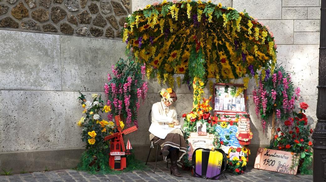 Montmartre som inkluderar utomhuskonst såväl som en kvinna
