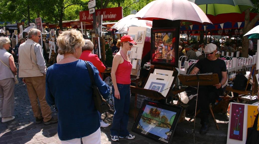 Montmartre som inkluderar performance art, marknader och en stad