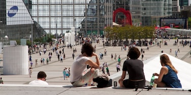 La Defense featuring a city and a square or plaza as well as a small group of people