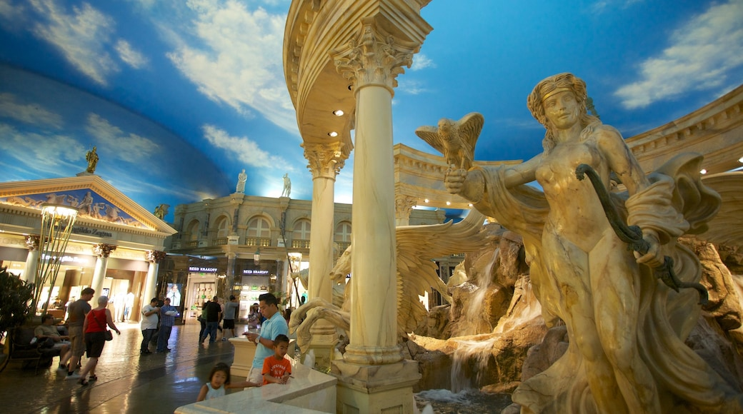 Forum Shops showing a fountain and outdoor art