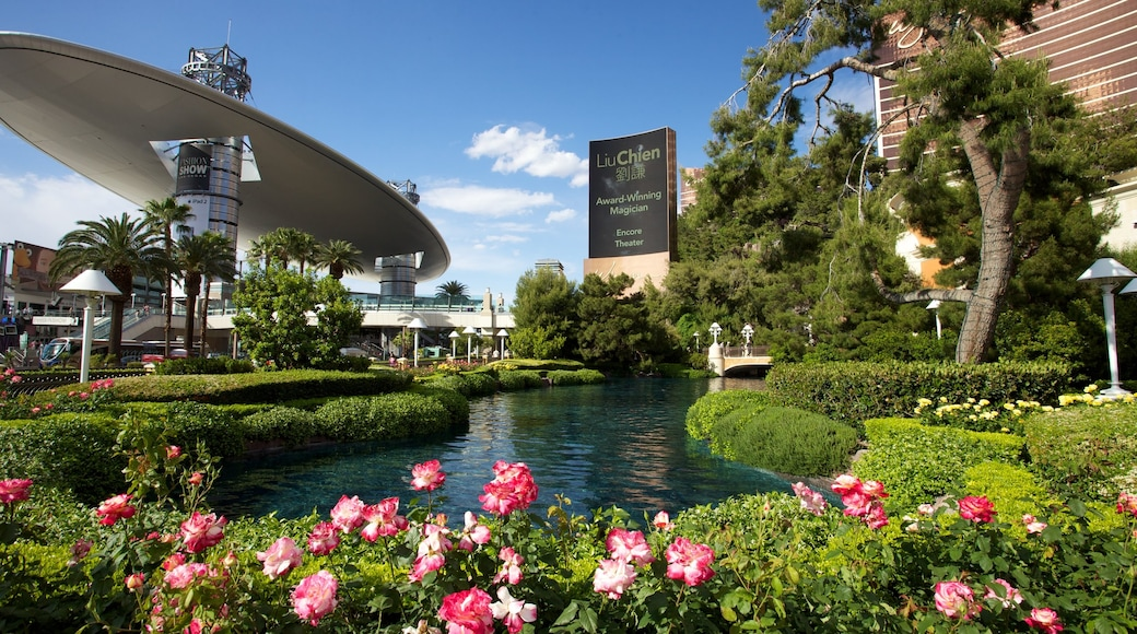 The Strip featuring a pond, a park and flowers