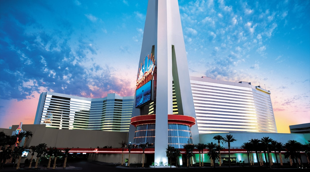 Stratosphere Tower showing a sunset, modern architecture and a city