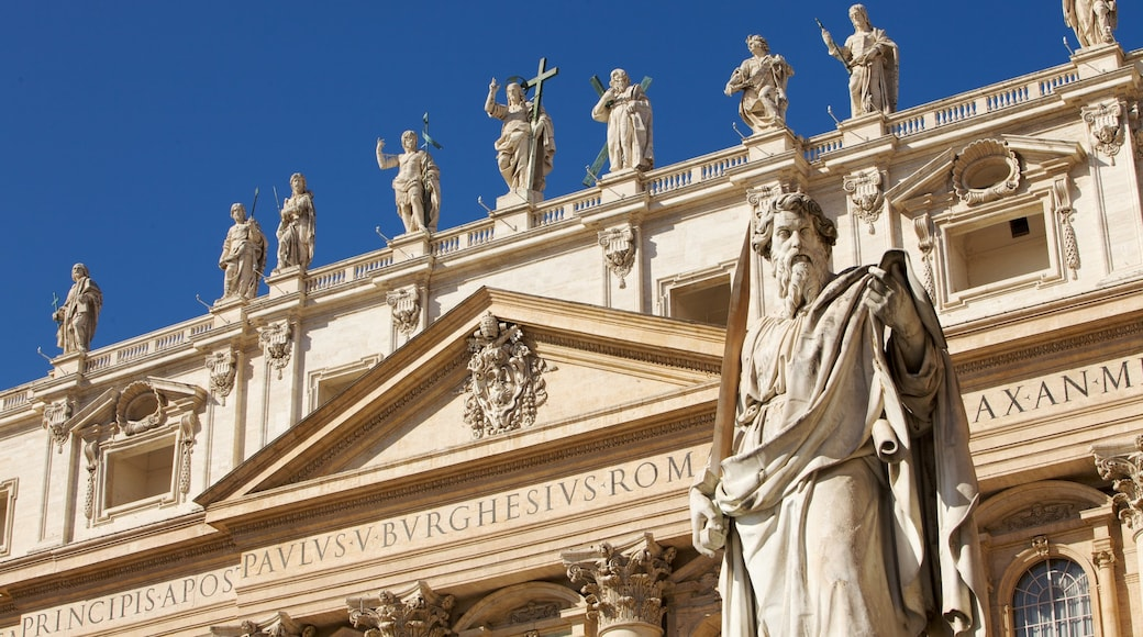 St. Peter\'s Basilica showing a monument, a temple or place of worship and a statue or sculpture