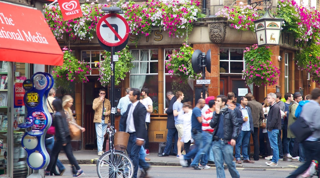 West End showing a city and street scenes as well as a large group of people
