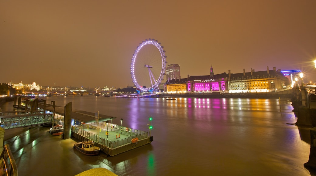 London Eye which includes a river or creek, a city and night scenes