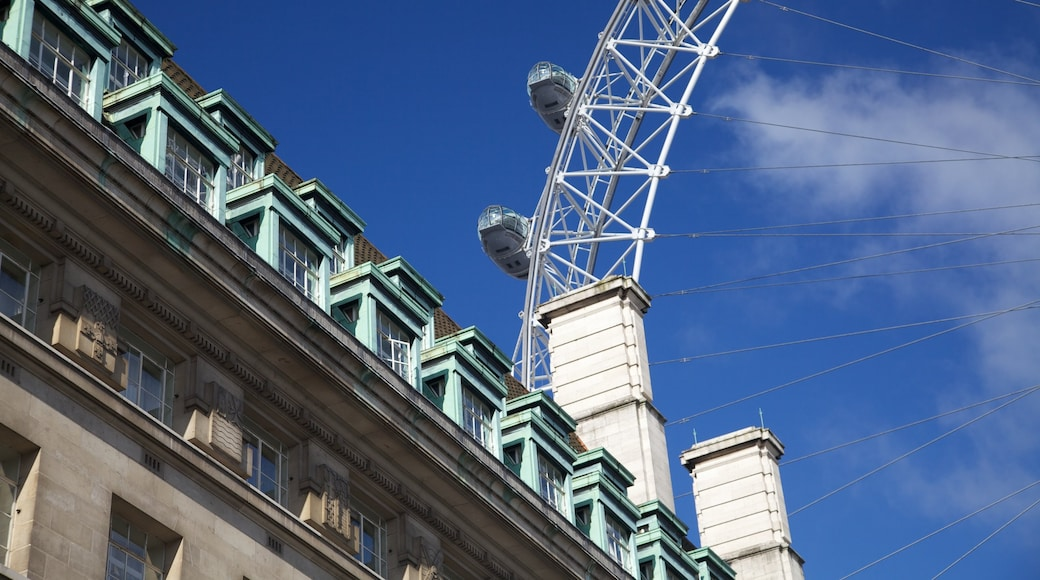 London Eye which includes a monument, a city and modern architecture